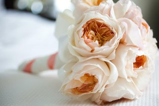 light-pink-and-orange-garden-roses-in-bridesmaid-bouquet