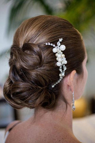 back-of-brides-updo-with-pearl-headpiece-on-side