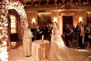 bride-and-groom-at-ballroom-wedding-at-flower-altar