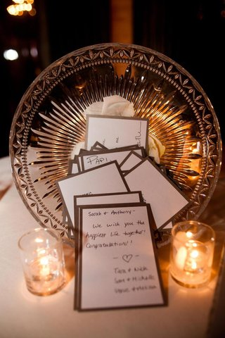 crystal-bowl-holding-candlelit-stationery-with-guest-notes