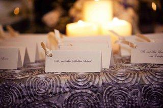 white-rectangular-escort-cards-with-ivory-ribbon