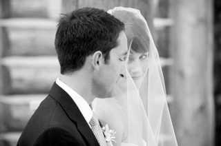 black-and-white-photo-of-couple-at-ceremony