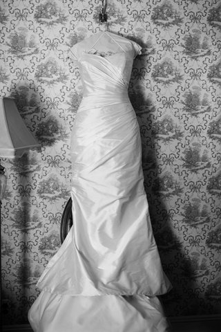black-and-white-photo-of-a-strapless-romona-keveza-gown-with-ruching