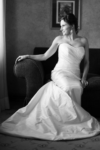 black-and-white-photo-of-a-bride-in-a-strapless-romona-keveza-dress