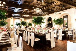 monstera-palm-centerpieces-at-indoor-beach-wedding-reception