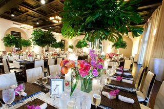 ballroom-wedding-with-palm-tree-centerpieces-and-orchids