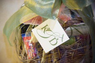 wicker-basket-filled-with-snacks-and-tied-with-green-ribbon
