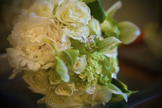 white-bridal-bouquet-with-rose-and-butterfly-jewel