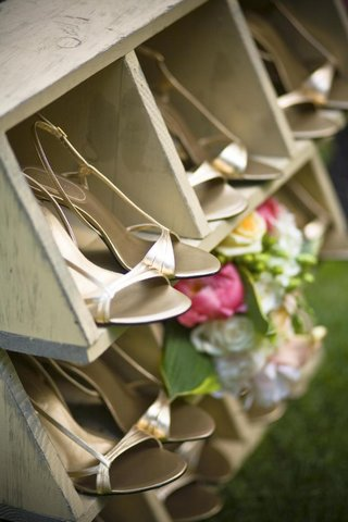 metallic-bridesmaid-heels-in-wooden-cubby