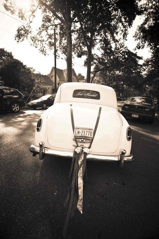 black-and-white-photo-of-old-fashion-wedding-car