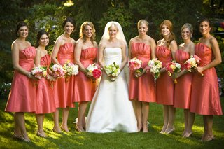 bride-with-bridesmaids-in-strapless-salmon-pink-dresses