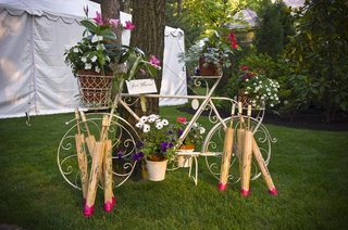 antique-bike-sculpture-with-potted-plants-and-parasols