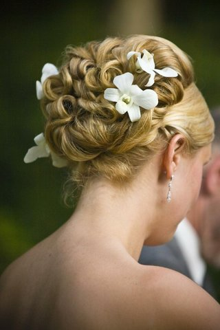 curled-wedding-hairstyle-updo-with-orchid-flowers