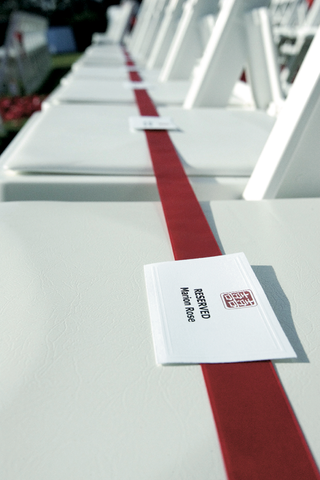long-red-ribbon-on-ceremony-chairs-labeled-reserved-seats