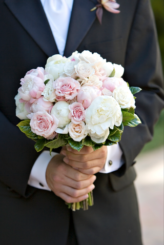 groom-holding-bridal-flowers