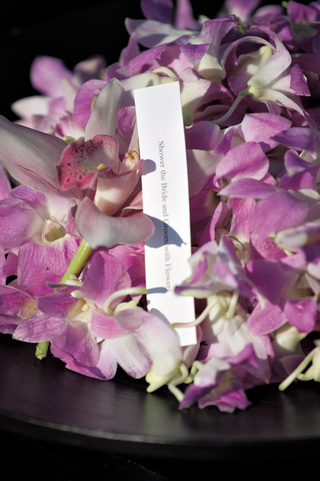 bowl-of-orchids-for-guests-to-toss-at-couple
