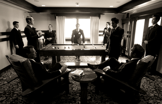 black-and-white-image-of-groomsmen-playing-pool