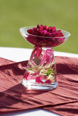 glass-vase-with-lilies-under-water-and-dahlia-in-bowl-on-top