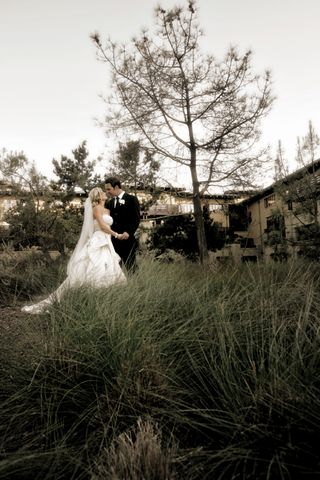 bride-in-pick-up-skirt-and-groom-in-field-at-la-jollas-the-lodge-at-torrey-pines