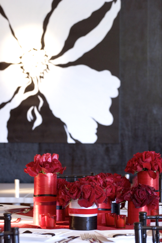 black-and-white-flower-painting-on-wall-and-red-centerpieces-on-table
