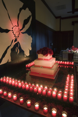 square-three-layer-wedding-cake-on-table-covered-with-candles