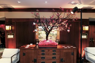 pink-cherry-blossom-tree-on-bed-of-flowers-with-place-cards