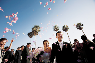 bride-and-groom-exit-outdoor-wedding-together