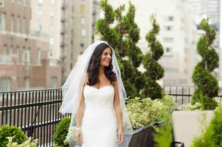 bride-in-white-strapless-dress-on-rooftop-garden