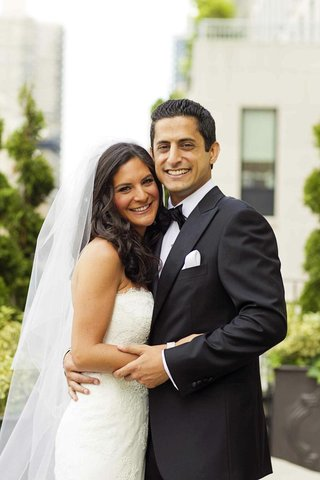 bride-with-white-dress-and-groom-in-black-tux-and-bow-tie