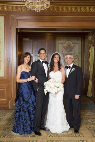 navy-mother-of-the-bride-dress-with-bride-and-groom