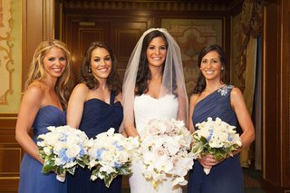 mismatched-bridesmaid-dresses-in-shades-of-blue