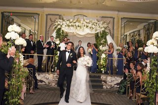bride-and-groom-walk-up-aisle-in-the-pierre-ballroom