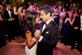 bride-and-groom-look-into-each-others-eyes-on-dance-floor
