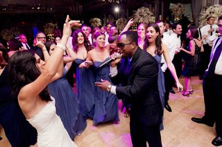 starlight-orchestras-performer-on-dance-floor-with-bride