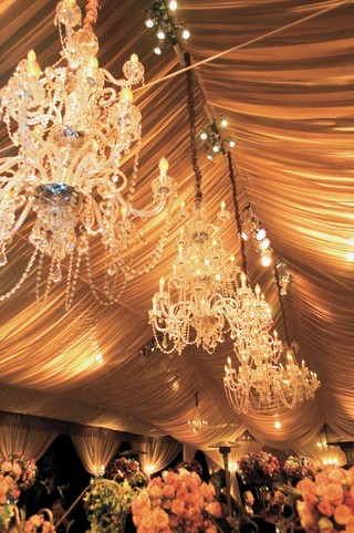 chandeliers-hanging-from-tented-wedding-reception