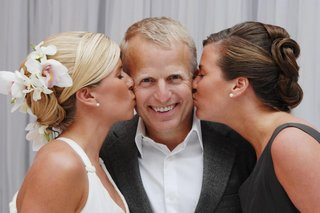 bride-and-sister-kiss-father-of-bride-on-cheek