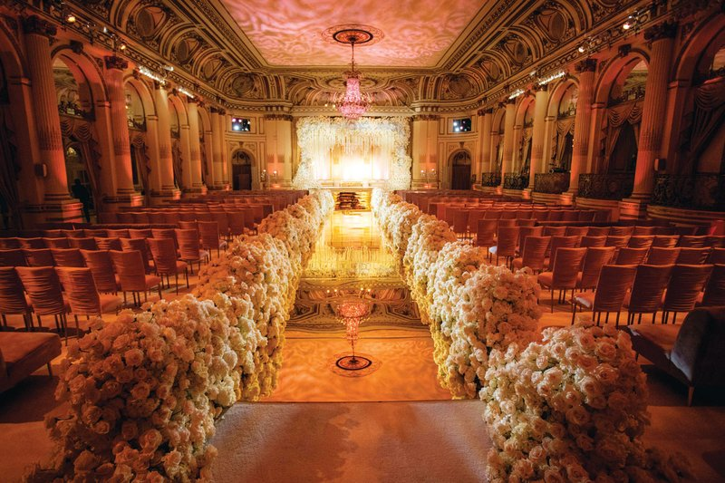 Lush Wedding Ceremony with Elegant Chairs