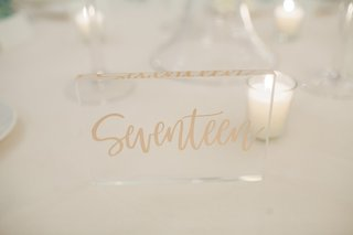 wedding-table-numbers-written-out-on-acrylic-slab