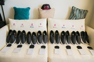the-black-and-white-dress-shoes-laid-out-for-the-groomsmen-vans-leather-look