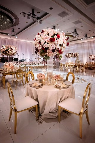 gold modern oval back chairs tall pink red centerpieces four seasons ballroom luxury wedding