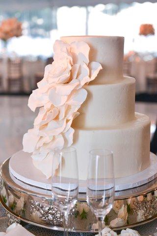 white-three-layer-wedding-cake-with-sugar-flower