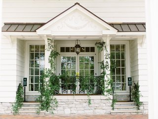 belle meade country club in nashville greenery on white building reception space