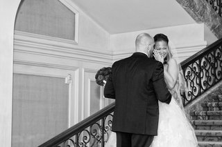 black-and-white-photo-of-bride-in-vera-wang-covering-her-face-and-laughing-with-groom