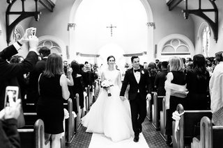 black-and-white-photo-of-bride-and-groom-recessional-catholic-church-ceremony-traditional