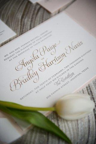 wedding-invitation-with-tulip-on-top-gold-foil-calligraphy-script-the-corinthian-houston-invitation
