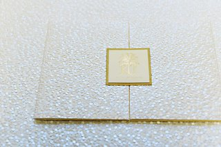sequined-wedding-invitation-with-a-gold-seal-of-the-wedding-crest
