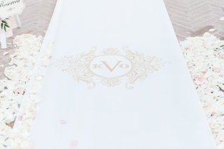 the-original-runner-company-white-aisle-runner-with-gold-monogram-flower-petals-on-both-sides