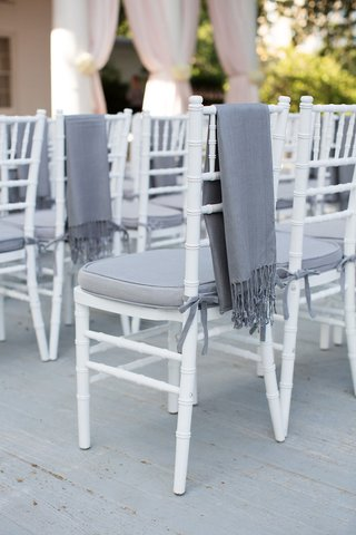 guest-chair-with-grey-cushion-and-throw-blanket-for-chilly-weather-outdoor-wedding