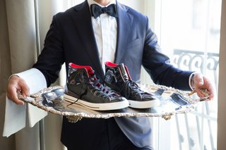 black-white-red-leather-converse-on-silver-platter-groom