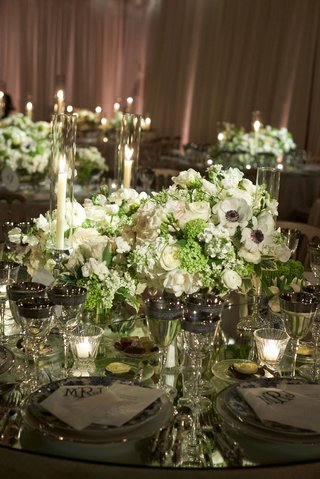wedding-reception-tented-ballroom-low-centerpiece-white-rose-anemone-ranunculus-greenery-tall-candle